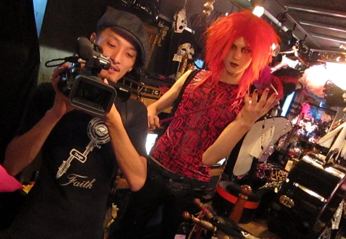 BABY DOLL: GOTH FETISH CLOTHING & ACCESSORIES STORE IN HARAJUKU. VENICE MASKS, LEATHER CORSET, LADY GAGA DRESS. banana fish dress, hime gyaru hairstyles, purple gothic hair, goth hair photos, kawaii tv, nhk, japanese television, japan national broadcaster, popular japanese tv show, cute girls tv host, NEW DARK PURPLE DYED HAIR COLOR & STYLE! NHK KAWAII TV SHOOT, GOTHIC LOLITA CORSET SHOP. Tokyo corsets, handmade secondhand clothes, best goth punk stores tokyo japan, vintage shopping, tokyo fashion diaries, lady gaga designer, ladygaga outfits