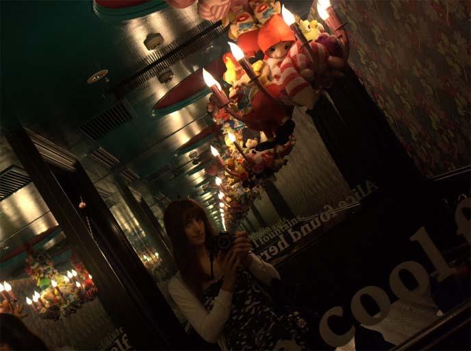 WORLD'S WEIRDEST RESTAURANTS, FOOD NETWORK: ALICE IN WONDERLAND CAFE, SHINJUKU TOKYO JAPAN. GOTH LOLITAS. bob blumer, tv host, travel channel, glutton for punishment, alice theme restaurant, alice wonderland restaurant, crazy japan theme cafes, maid cafes, tv hosting, fixing, japan production arrangers
