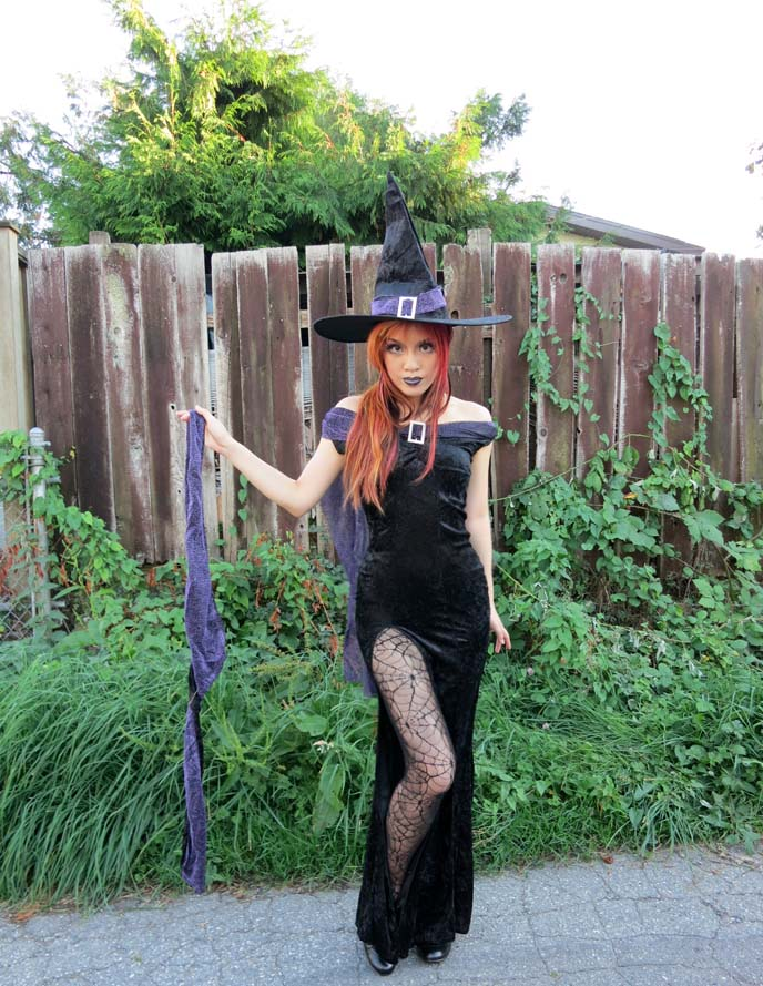 witch costume, sexy womens costumes, halloween 2012 costumes, women costumes, witch outfit, witch makeup, long goth gown, tight dress with long leg slit, elegant witch, pointy hat, cosplay, wicked witch costumes, 2012 halloween costume, goth makeup, black purple lipstick, halloween costume ideas, gothic witch