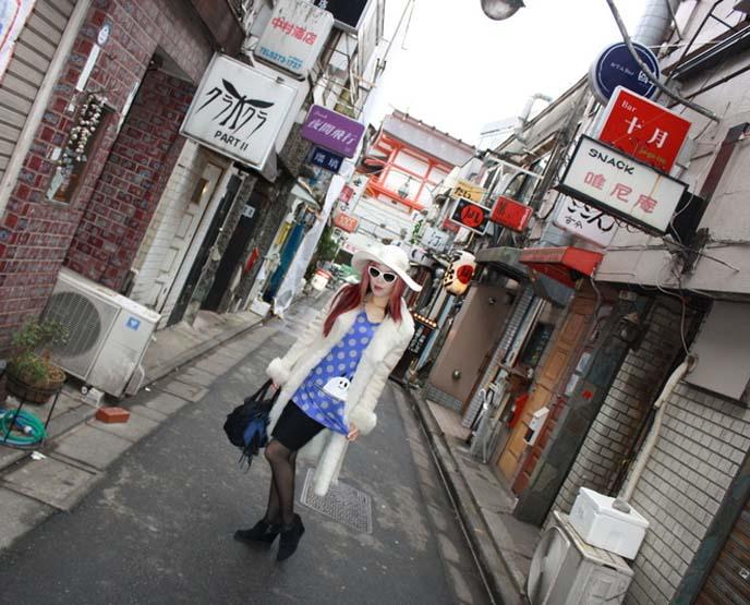 peace now ghost shirt, golden gai, shinjuku bars street, tokyo bar signs