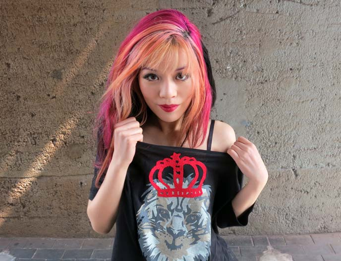 pink hairstyle, pink dyed hair, 1980s hairstyle, off the shoulder shirt, lion tshirt