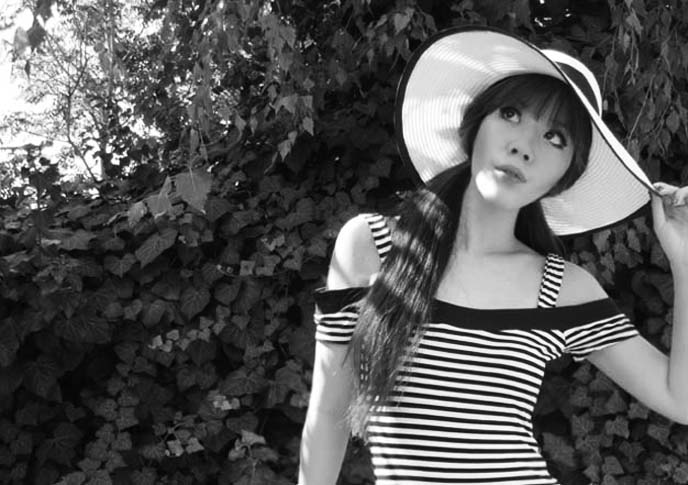 black white striped shirt, sun hat