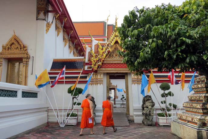 orange robe monks in temple