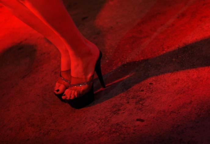 man wearing women's heels