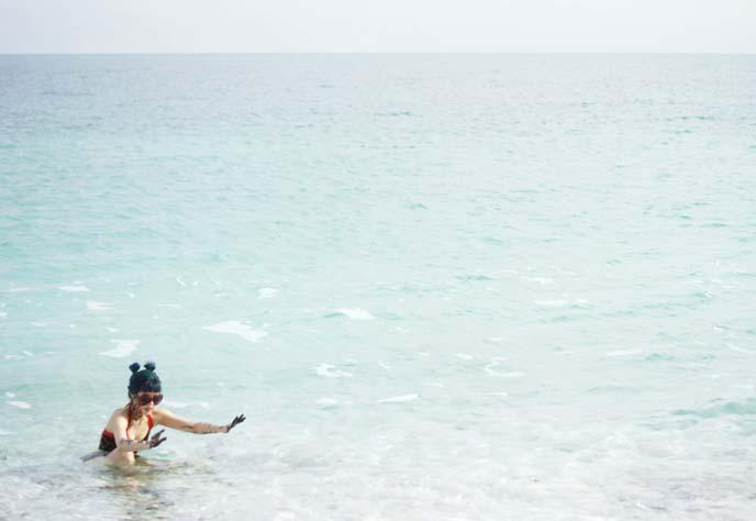 girl floating in dead sea water