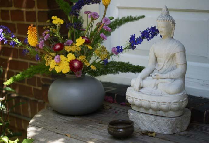 buddhist altar, flowers statue
