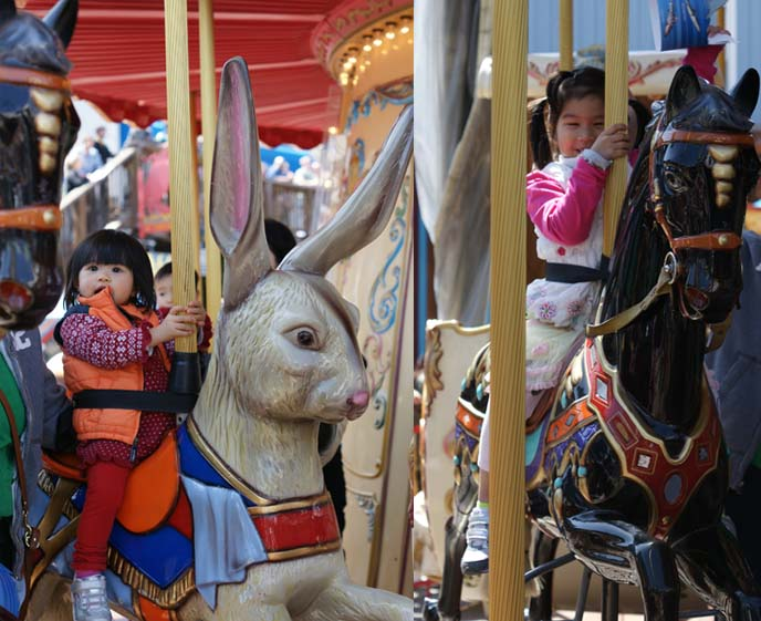 asian kids on horses carousel ride