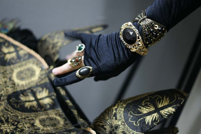 gold bracelets, rings on hand