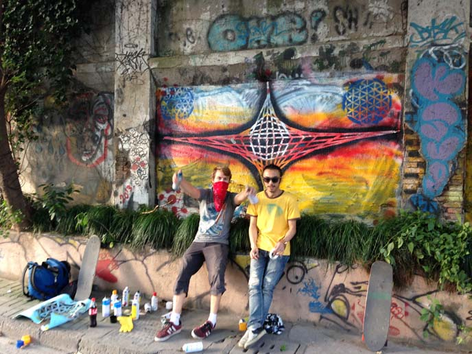 artists spray painting mural
