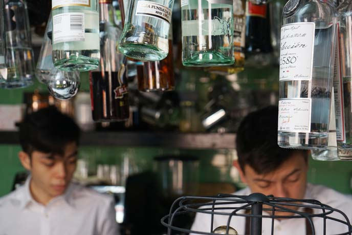 hanging bottles bar, bartenders