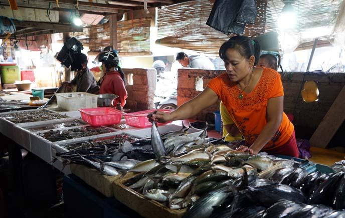 women selling seafood, fish asia