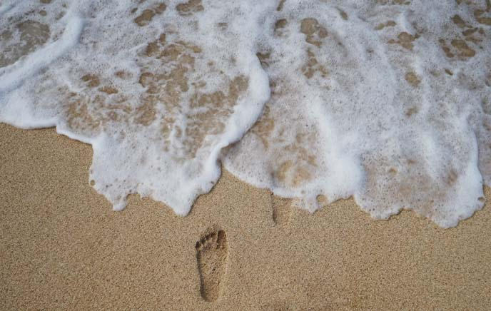 footprint in sand, ocean foam