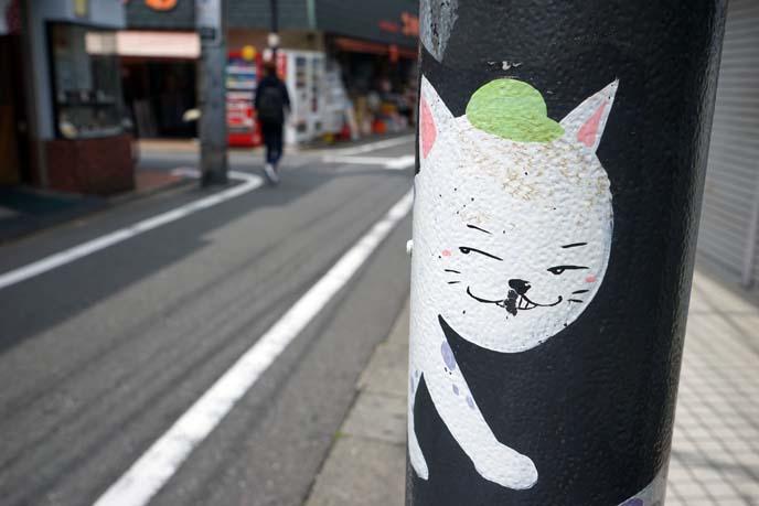 gotokuji cat art poles