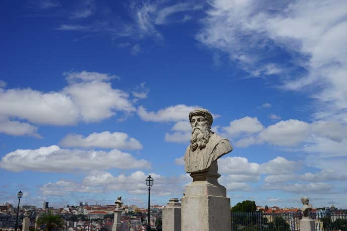lisbon clouds blue sky, sculptures
