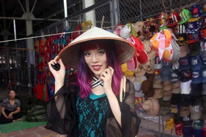 girl wearing vietnamese pointed hat