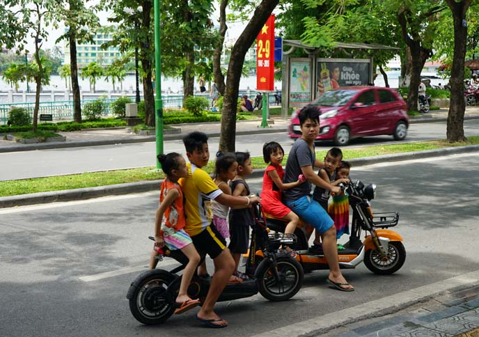 vietnamese children balancing on motorcycle
