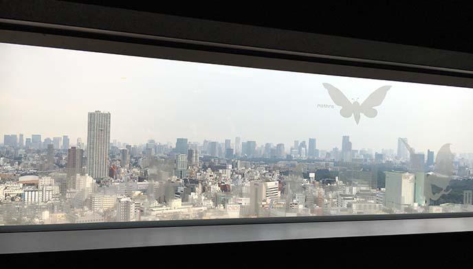 mothra flying over tokyo