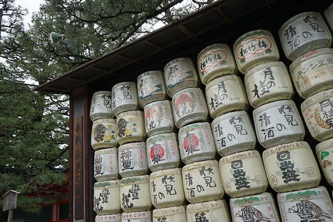 sake barrels in front of shrines, japan