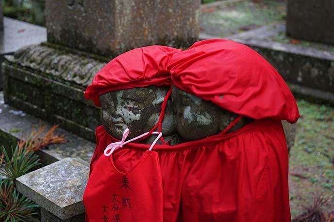 koya buddha statues wearing hats