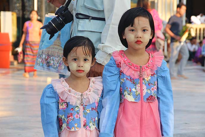 burmese children wearing thanaka face paint
