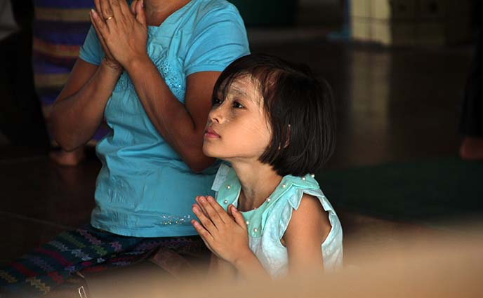 praying burmese girl child