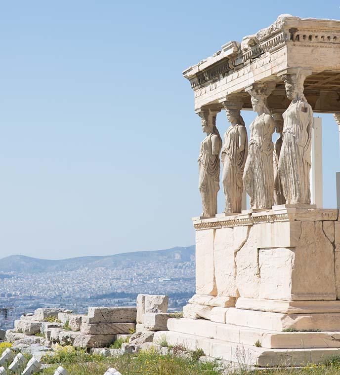 women pillars statues acropolis
