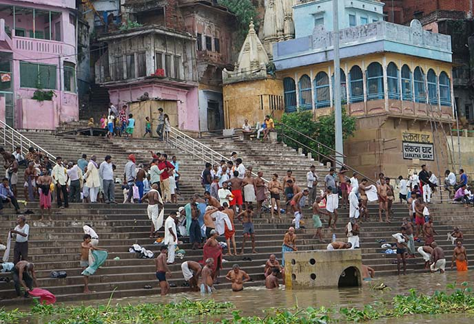 men bathing in river ganges