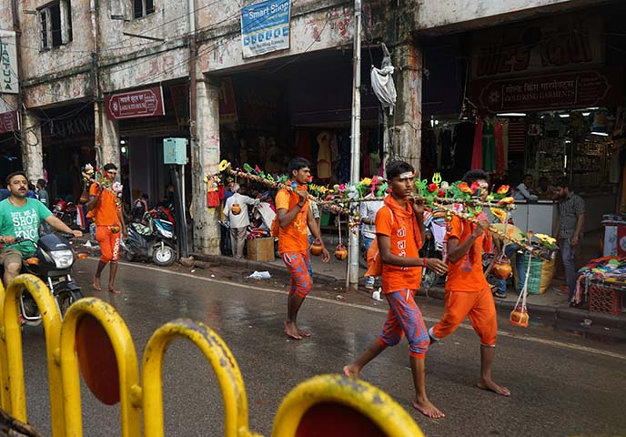 indian pilgrims wearing orange