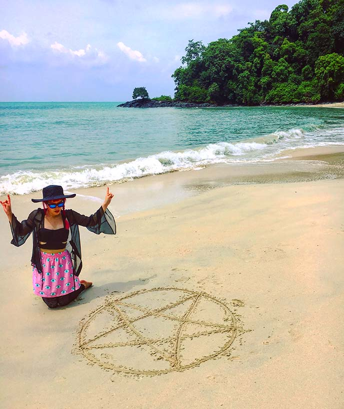pentagram in sand, beach gothic