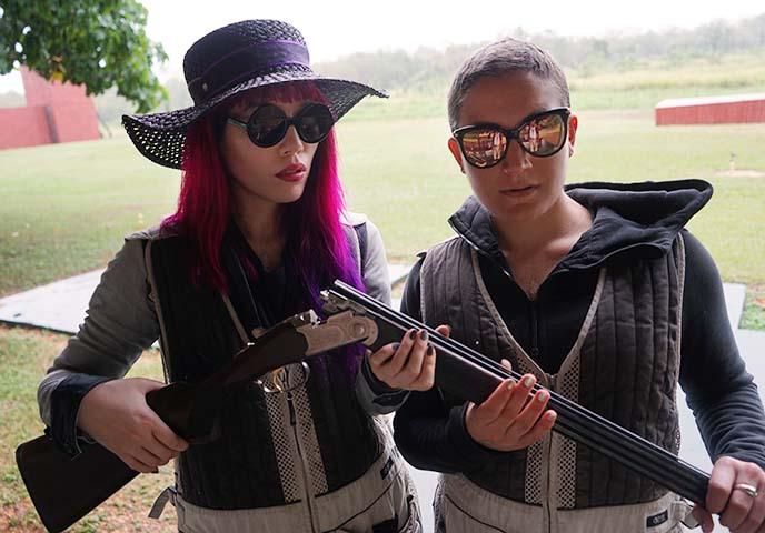 girls posing with shotgun