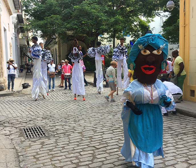 havana festival parade stilt walkers