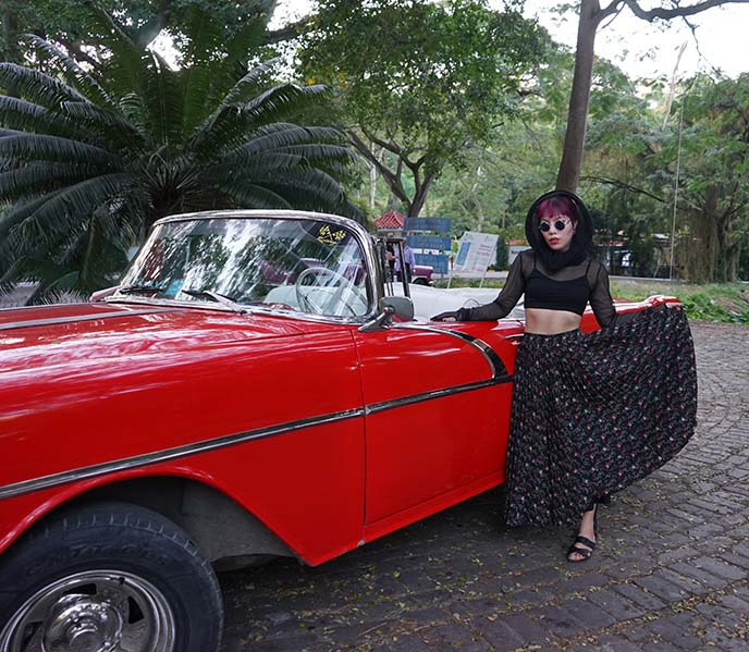 girl with antique cuban car