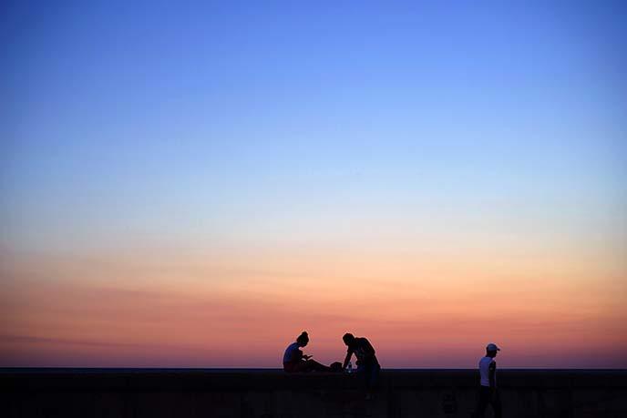 sunset silhouette havana cuba seawall