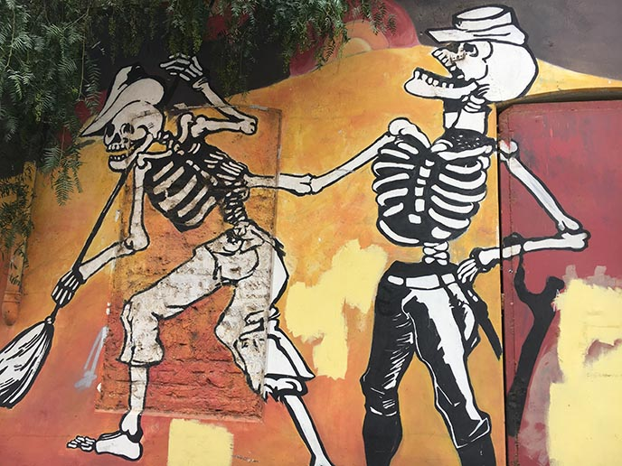 laughing skeletons mural