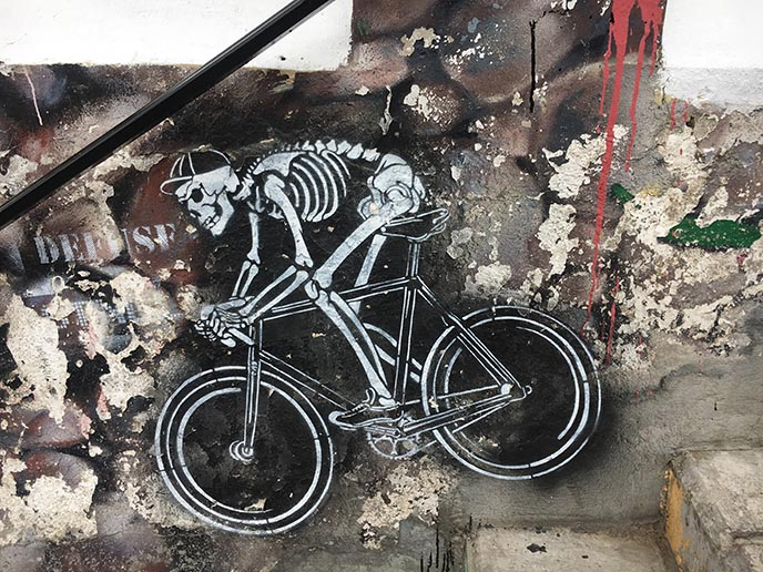 bicycling skeleton graffiti