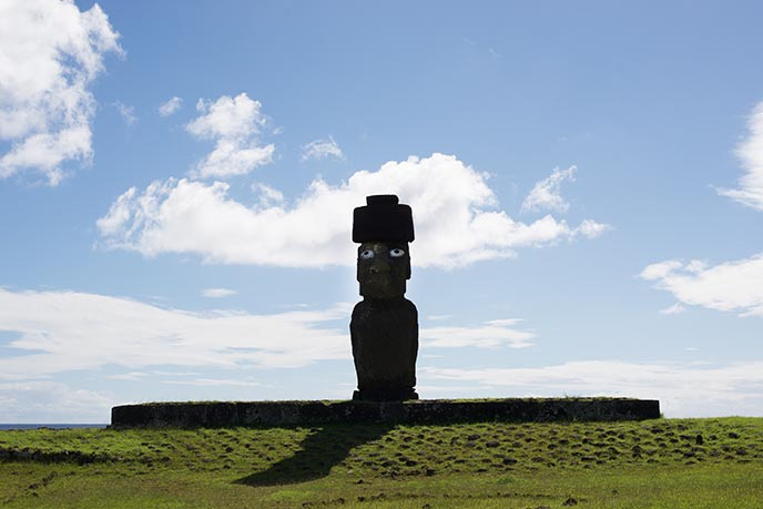 moai with eyes wearing hat
