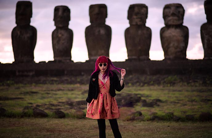 girl in front of easter island statues