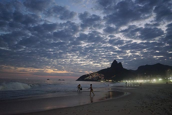 sunset ipanema beach mountains