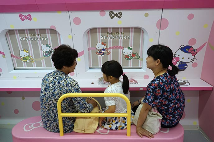 kids riding japanese hello kitty train