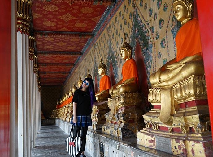 row gold buddha statues thailand