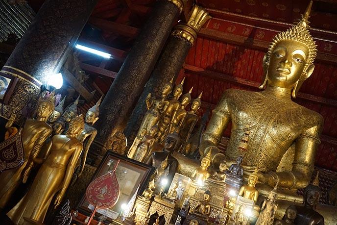 gold buddha statue wat mai laos