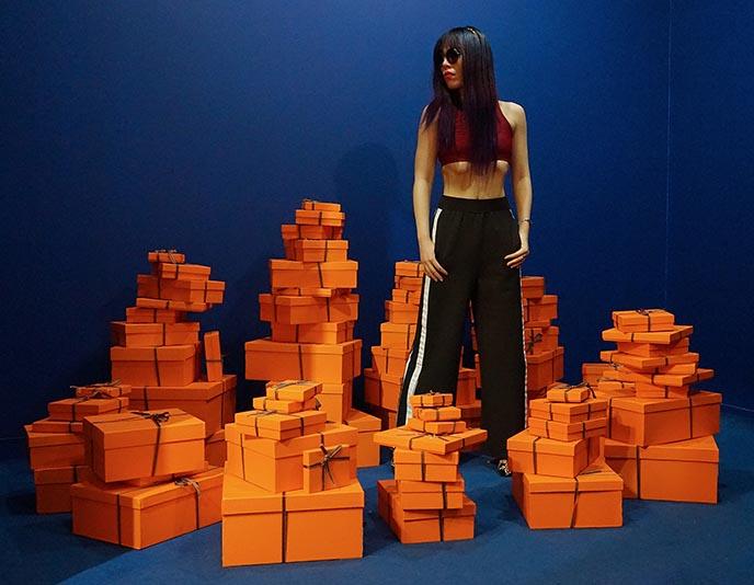 pile of hermes orange boxes musee du bonbon