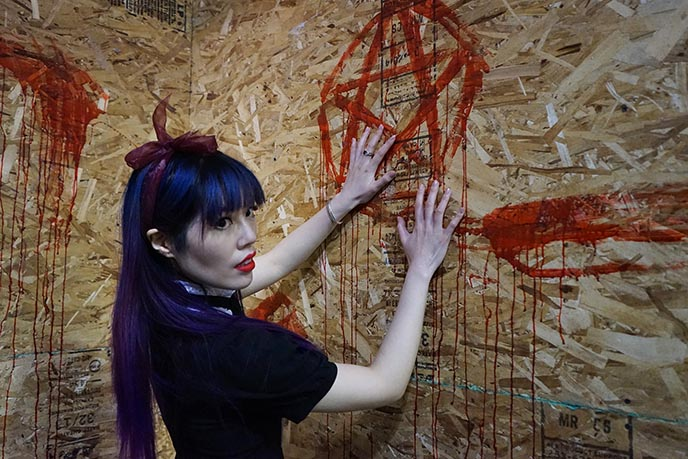 bloody red pentagram on wall