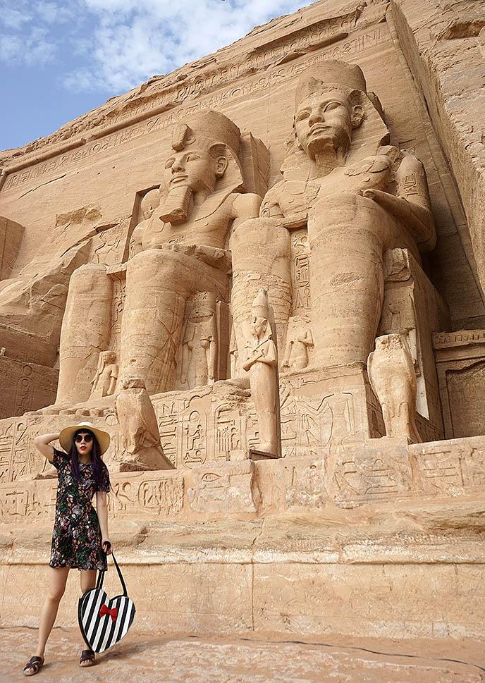 ramses ii statues abu simbel girl traveler