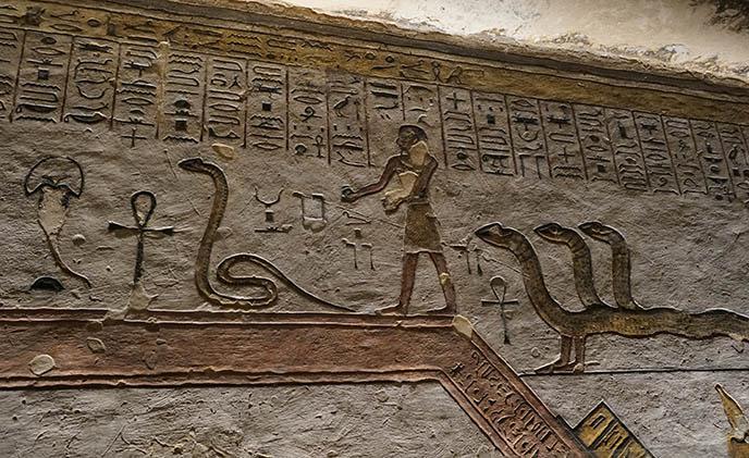 egyptian three headed snake carving