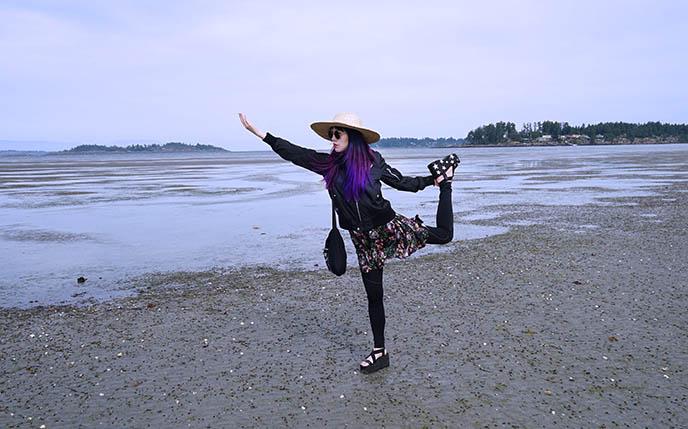 travel blogger yoga pose beach