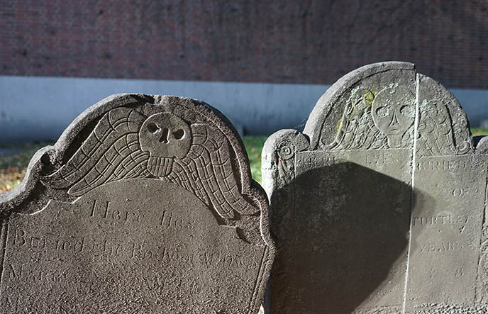 puritans winged skulls symbol tombstones