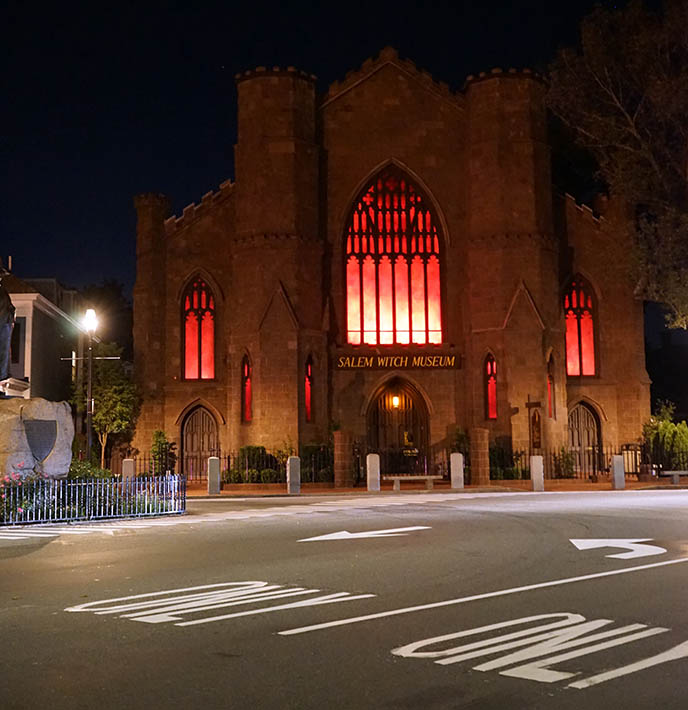 salem witch museum church building glowing red night