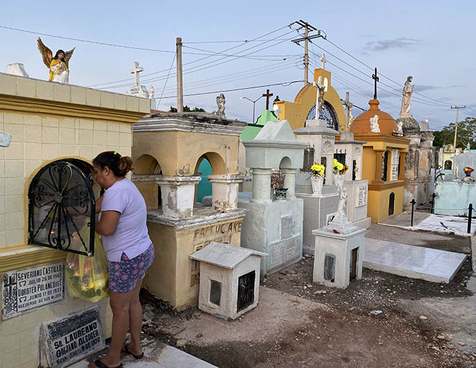 mexicans cleaning graves tombs