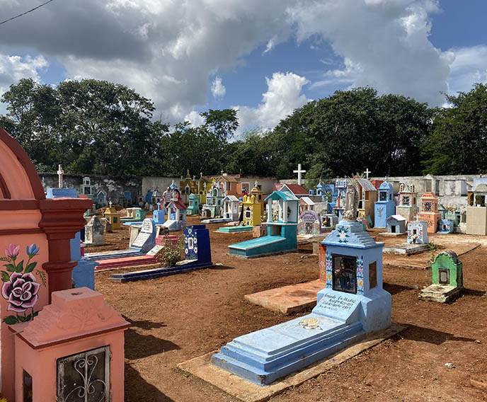 painted colored tombs mexican cemetery art statues